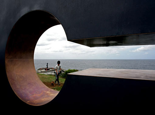 a boy walks his dog past the mild steel and bronze work 'She Thought' by Australian artist Mark McClelland. The annual outdoor display features sculptures by 109 artists from eight countries and is expected to attract over 500,000 visitors before closing on November 2