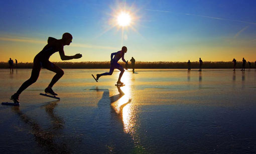 skaters compete on track of ice in northern Dutch province of Frieslands