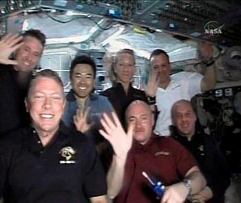 crew of shuttle Discovery: Mike Fossum, Mark Kelly and Garrett Reisman; Ken Ham, Akihiko Hoshide, Karen Nyberg and Ron Garan
