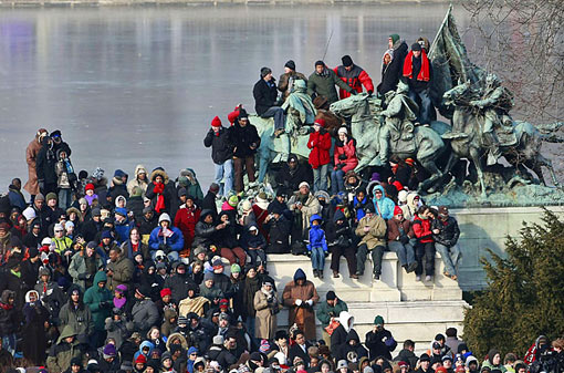 Standing Room Only: spectators for the swearing-in ceremony seek perches on the National Mall