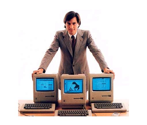 proud of his company's creations, Apple co-founder Steve Jobs shows off the original Macintosh as it was launched in January 1984