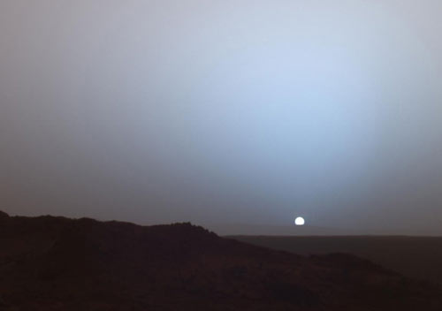 NASA's Mars Exploration Rover Spirit captured this stunning view as the Sun sank below the rim of Gusev crater on Mars