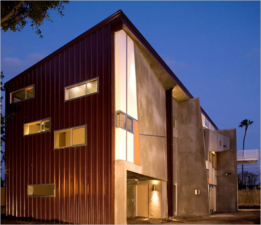 Thomas Small and Joanna Brody's eco-friendly house in Culver City, Calif., is made of a prefabricated steel shell with windows set into burgundy-toned panels, and a south wall made of concrete, acrylic and glass