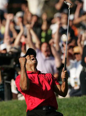 Tiger Woods sinks birdie putt on the 18th green forcing a playoff against Rocco Mediate during the 4th round of the US Open championship at Torrey Pines Golf Course