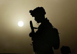Marine speaks on radio during patrol in Helmand Province of Afghanistan