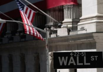 a sign for Wall Street outside the New York Stock Exchange