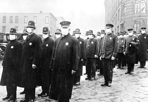 Policemen in Seattle wearing masks made by the Red Cross, during the Spanish-influenza epidemic. December 1918. Citizens were urged to stay indoors and avoid congested areas.
