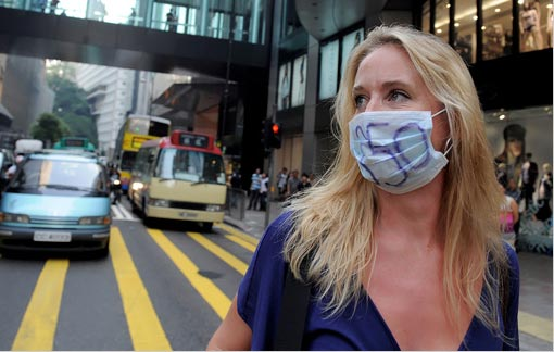 A woman in Hong Kong's central district. In a campaign organized by the environmental movement 350.org, activists are pressing the world's leaders to reach a climate change accord at talks in Copenhagen in December.
