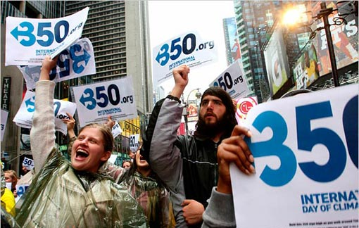 Kathleen Jordan, of New York, left, and others participate in an International Day of Climate Action rally on Saturday in New York's Times Square.