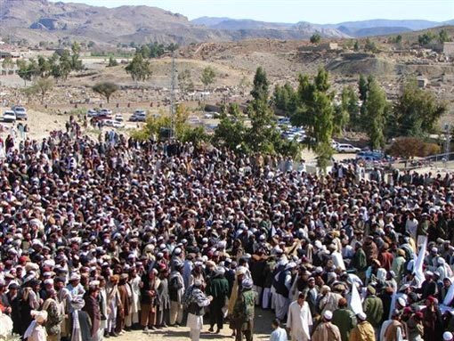 Pakistani tribesmen gather for funeral prayers for the victims of a missile strike
