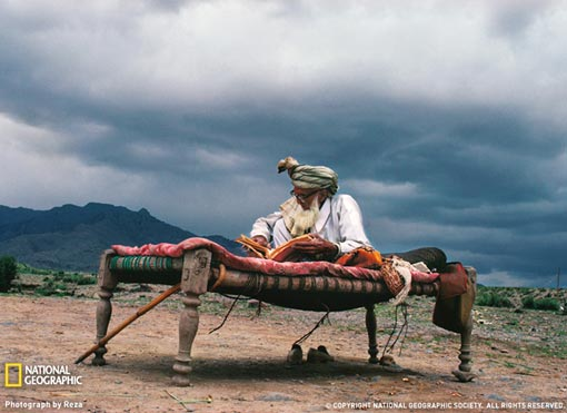National Geographic Photo of the Day: Fleeing the war in Afghanistan, an elderly man set up a temporary home within sight of the Afghan mountains he loved.