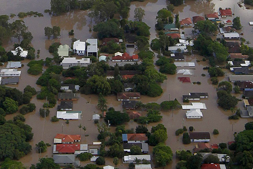 flooded Brisbane River in residential areas in Brisbane's south
