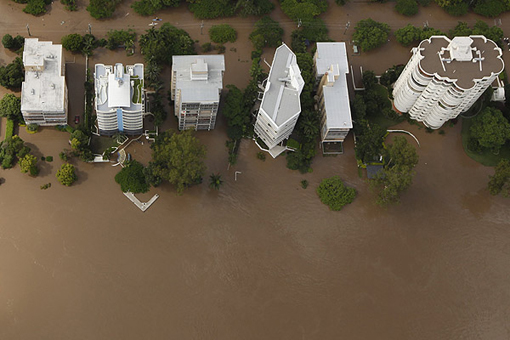 Apartment towers on the Brisbane riverfront surrounded by water on January 13 2011