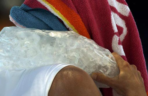 Zvonareva cools down with an ice pack during her match against Bartoli at the Australia Open
