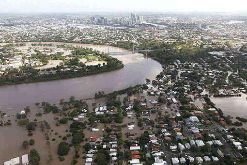 flooded Brisbane River spills into residential areas close to the CBD