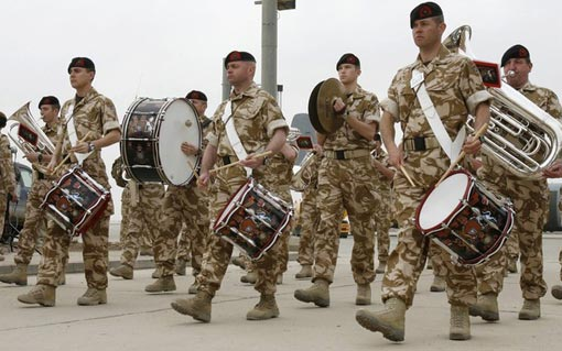 British military band performs during handover ceremony of Basra's international airport from British forces to U.S. forces