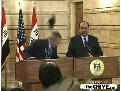journalist throws shoe at Bush in Iraq