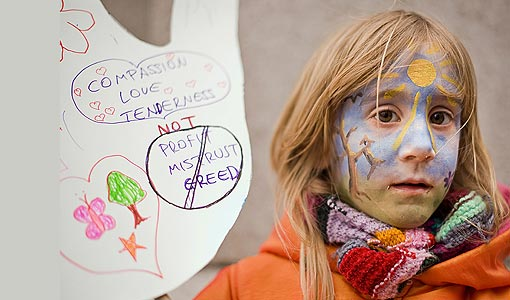 6-year-old Daci holds a placard as she participates in 'The Wave' demonstration supporting action on climate change as the march begins through central London. Organized by the Stop Climate Chaos Coalition, the protest aims to highlight public concern ahead of the UN climate summit in Copenhagen.