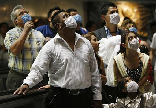 Mexico: people wearing protective masks pay respects to Our Lady of Guadalupe as they passed Guadalupe's shrine at the Basilica de Guadalupe
