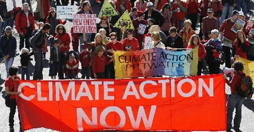 Protesters hold banners to demand for climate action in Sydney. Leaders will seek an ambitious mitigation outcome at Copenhagen to reduce the risks of global warming.
