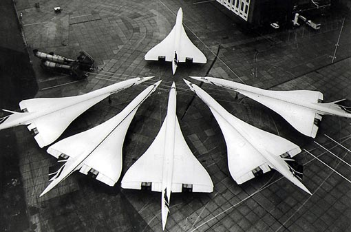 A cluster of Concordes gather nose-to-tail at London's Heathrow airport. Air France and British Airways ran a regular transatlantic service to New York with an average flight time of just 3 and a half hours.