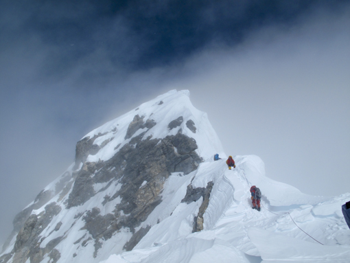 halfway between the South Summit and the summit of Everest is a steep spur of rock and ice now called the Hillary Step