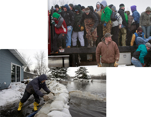 Russ Richards adds a sandbag onto the dike surrounding his home in Fargo, North Dakota, March 26, 2009. The dike protects the house from the flooding Red River.