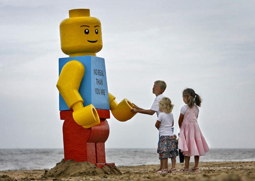 children play with a giant smiling Lego man that was fished out of the sea in the Dutch resort of Zandvoort in 2007
