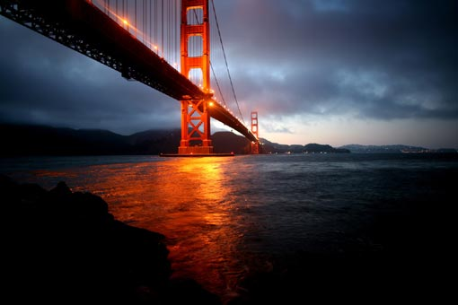 One of the world's longest suspension bridges, extending for about nine-tenths of a mile, San Francisco's Golden Gate Bridge hangs 220 feet above the water, reaches 746 feet high, and boasts cables that can support 200 million pounds