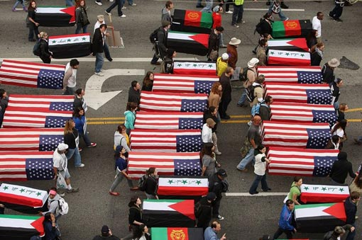 anti-war demonstrators on Hollywood Boulevard carry model coffins to mark the 6th anniversary of the Iraq War