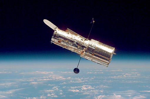 Hubble Telescope orbits at a speed of five miles per second, 353 miles above Earth