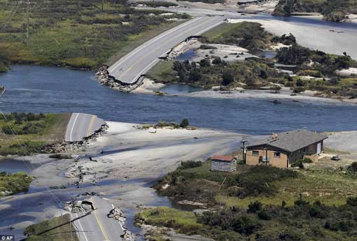 Destruction: Route 12 on Hatteras Island, North Carolina, after Irene swept through the area, cutting the roadway in five locations