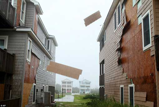 Unhinged: The hurricane force winds of Irene rip the siding off of homes on Nags Head, North Carolina