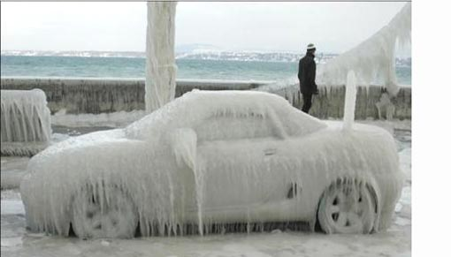 cars encased in ice, immobile