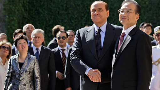 Italian Premier Silvio Berlusconi, shakes the hand of Chinese Premier Wen Jiabao, right, as they arrive for a joint news conference at Villa Madama in Rome