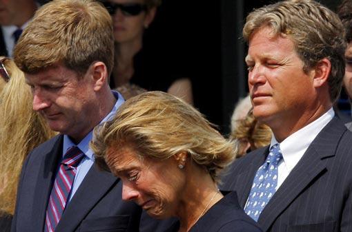 Senator Kennedy's daughter Kara Kennedy Allen, center, weeps alongside her brothers U.S. Congressman Patrick Kennedy, left, and Edward Kennedy Jr.