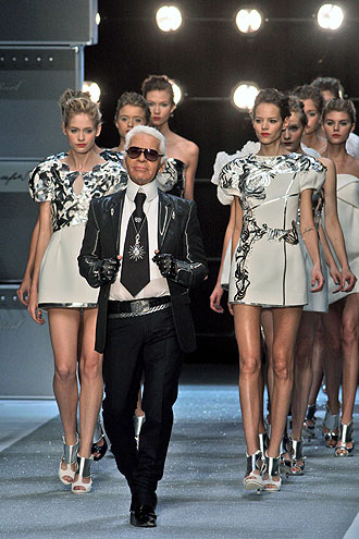 The world of fashion is about 'dreams and illusions', Karl Lagerfeld said, dismissing as 'absurd' the debate prompted by Brigitte magazine which said it would no longer feature professional models on its pages.