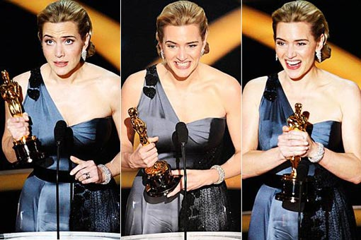 Kate Winslet accepts the award for best actress in a leading role for her performance in The Reader