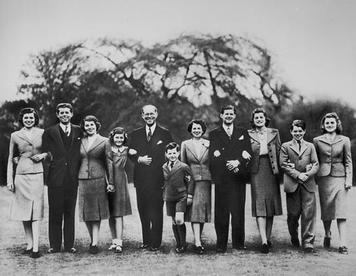 The Kennedy family in 1939: Joseph Kennedy Sr. (fifth from left) and his wife Rose (fifth from right) pose for a family portrait on the grounds of the U.S. embassy in London, where Joe was serving as U.S. ambassador to the U.K. The kids include, from left: Eunice, John, Rosemary, Jean, Edward, Joseph Jr., Patricia, Robert and Kathleen.