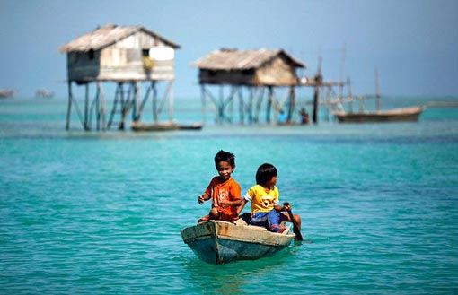 sea gypsies: two kids on a boat near home