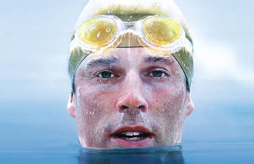 In only a Speedo and a silicone cap, Pugh had swum an entire kilometer among the great icebergs of the Antarctic and repeated the distance at the top of the world too.