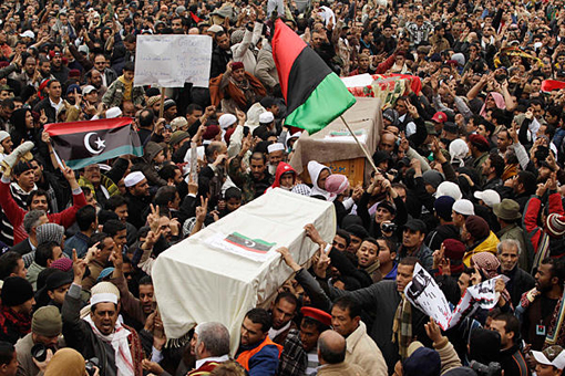 On Feb. 25, mourners carry coffins containing the bodies of Libyans who were killed in the recent clashes in Benghazi.