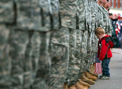 3-year-old boy saying goodbye to father who was being deployed
