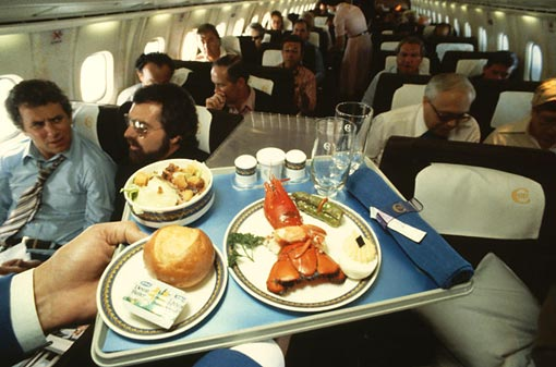 A passenger gets set for a lobster dinner on board. Concorde could never be called a cheap way to fly, but you were able to beat time itself by arriving in New York an hour earlier than you left London, and enjoy some fine dining in the process. The food was served on Wedgwood crockery with short silver cutlery.