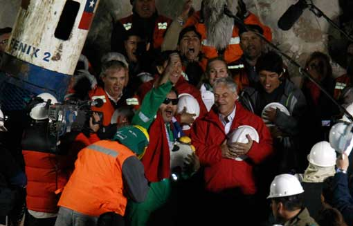 Luis Urzua, the last miner to be rescued, next to Chile's President Sebastian Pinera
