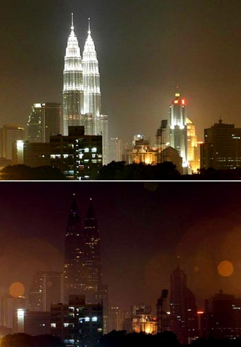 Malaysia's landmark, the Petronas Twin Towers along with other buildings before and after the lights were switched off to mark Earth Hour in Kuala Lumpur, Malaysia, 28 March 2009
