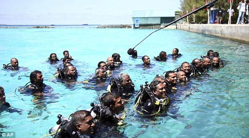 the ministers surfaced to speak to the media in their scuba gear