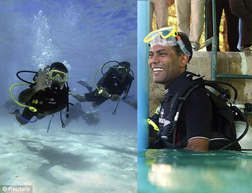Maldives President Mohamed Nasheed swims to the first underwater cabinet meeting in the Maldives. Right, the president tries on diving gear before the historic meeting