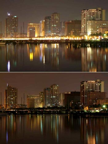 A commercial and residential district reflected on Manila Bay before (top) and during (below) Earth Hour in Metro Manila, Philippines 28 March 2009. The Philippines joined countries around the world in symbolically switching off non-essential lights for one hour to create awareness about the dangers of climate change