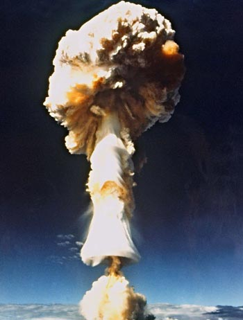 a mushroom cloud rises above Mururoa Atoll, French Polynesia, after a French nuclear test there in 1970